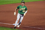 Oakland Athletics' Mark Canha advances to third base on a passed ball during the third inning of a baseball game against the Kansas City Royals, Tuesday, Sept. 14, 2021 in Kansas City, Mo. (AP Photo/Reed Hoffmann)