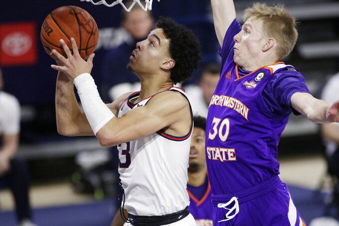 Gonzaga guard Andrew Nembhard (3) shoots in front of Northwestern State guard Trenton Massner (30) during the second half of an NCAA college basketball game in Spokane, Wash., Monday, Dec. 21, 2020. (AP Photo/Young Kwak)