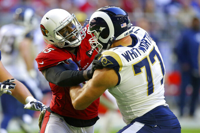 Arizona Cardinals linebacker Chandler Jones, left, battles Los Angeles Rams offensive tackle Andrew Whitworth (77) during the first half of an NFL football game, Sunday, Dec. 1, 2019, in Glendale, Ariz. (AP Photo/Ross D. Franklin)
