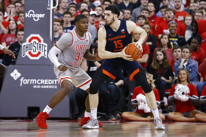 Illinois' Giorgi Bezhanishvili, right, posts up against Ohio State's E.J. Liddell during the second half of an NCAA college basketball game Thursday, March 5, 2020, in Columbus, Ohio. Ohio State won 71-63. (AP Photo/Jay LaPrete)