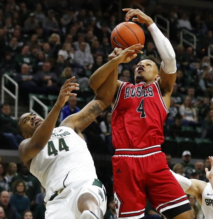 Michigan State forward Nick Ward (44) and Northern Illinois forward Lacey James (4) fight for the rebound during the first half of an NCAA college basketball game, Saturday, Dec. 29, 2018, in East Lansing, Mich. (AP Photo/Carlos Osorio)