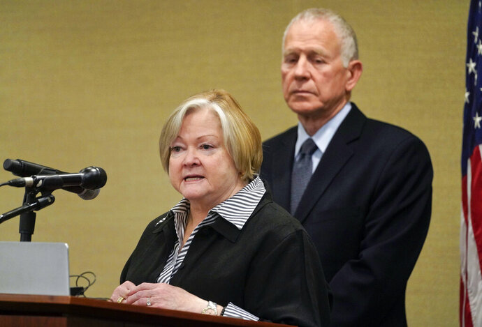 FILE - In this Oct. 29, 2018, file photo, Judy Shepard, left, and her husband Dennis Shepard, right, speak at a law enforcement roundtable on improving the identification and reporting of hate crimes at Department of Justice in Washington. The parents of murdered gay college student Matthew Shepard have accused Attorney General William Barr of hypocritical stances on LGBT rights. The criticism came Wednesday, during a Justice Department ceremony focused on a hate-crimes law named after their son. Matthew Shepard was killed in 1998. (AP Photo/Pablo Martinez Monsivais, file)