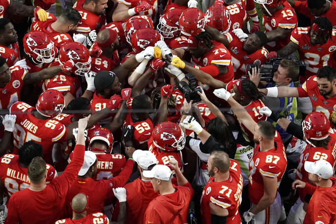 Kansa City Chiefs' players huddle before the NFL Super Bowl 54 football game between the San Francisco 49ers and Kansas City Chiefs Sunday, Feb. 2, 2020, in Miami Gardens, Fla. (AP Photo/Morry Gash)