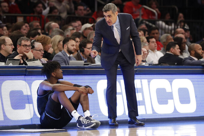 Villanova head coach Jay Wright, right, talks to Bryan Antoine during the second half of an NCAA college basketball game against St. John's Tuesday, Jan. 28, 2020, in New York. Villanova won 79-59. (AP Photo/Frank Franklin II)