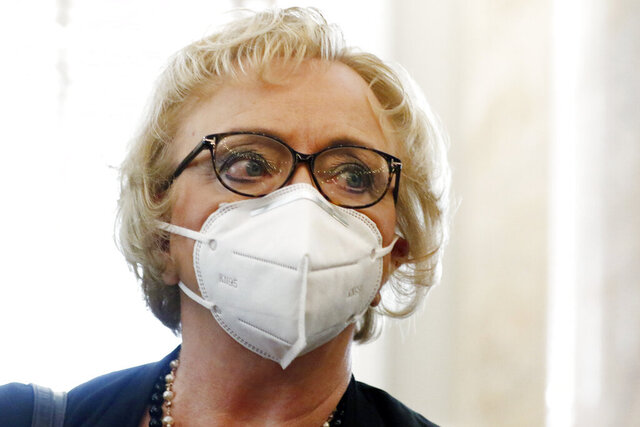 State Superintendent Carey Wright, follows virus protocol and remains masked while speaking to lawmakers following a legislative hearing on distance learning and broadband for schools Wednesday, May 13, 2020, at the Capitol in Jackson, Miss. The impact of COVID-19 forced school closure statewide and use of the existing broadband system for learning proved to be taxing, especially in rural communities. (AP Photo/Rogelio V. Solis)