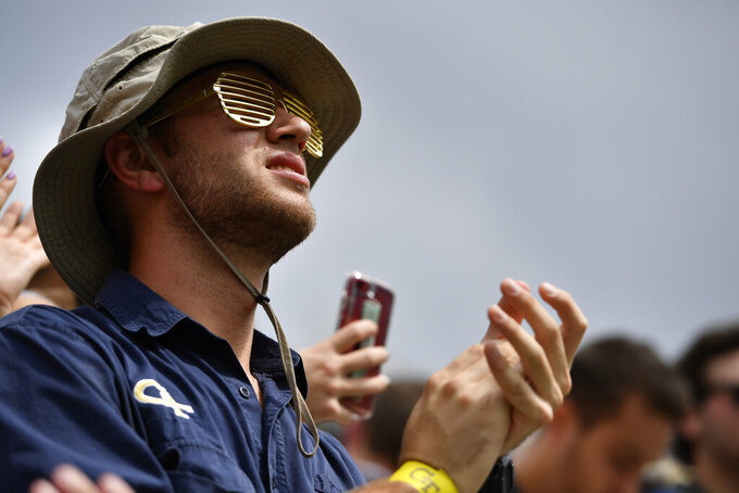 A fan watches play during the first half of an NCAA college football game between Georgia Tech and Citadel, Saturday, Sept. 14, 2019, in Atlanta. (AP Photo/Mike Stewart)