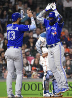 Toronto Blue Jays' Teoscar Hernandez, right, celebrates his three-run home run off Houston Astros relief pitcher Cionel Perez with Lourdes Gurriel Jr. during the sixth inning of a baseball game, Sunday, June 16, 2019, in Houston. (AP Photo/Eric Christian Smith)