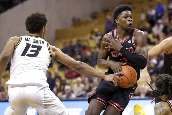 Georgia's Anthony Edwards heads to the basket as Missouri's Mark Smith (13) defends during the first half of an NCAA college basketball game Tuesday, Jan. 28, 2020, in Columbia, Mo. (AP Photo/Jeff Roberson)
