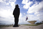 The silhouette of national hero Augusto C. Sandino towers over the Tiscapa Lagoon in Managua, Nicaragua, Thursday, June 17, 2021. In recent weeks, Nicaragua President Daniel Ortega's government has rounded up 13 opposition leaders, including four presidential challengers for the Nov. 7 elections. They face allegations ranging from money laundering to crimes against the state. (AP Photo/Miguel Andres)