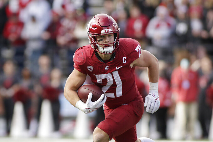 Washington State running back Max Borghi carries the ball during the second half of an NCAA college football game against BYU, Saturday, Oct. 23, 2021, in Pullman, Wash. BYU won 21-19. (AP Photo/Young Kwak)