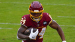 Washington Football Team running back Antonio Gibson (24) running downfield during the first half of an NFL football game against Dallas Cowboys, Sunday, Oct. 25, 2020, in Landover, Md. (AP Photo/Susan Walsh)
