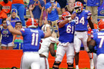 Florida tight end Kyle Pitts (84) celebrates his touchdown catch from quarterback Kyle Trask (11) with offensive lineman Brett Heggie (61) during the first half of an NCAA college football game against South Carolina, Saturday, Oct. 3, 2020, in Gainesville, Fla. (AP Photo/John Raoux,Pool)