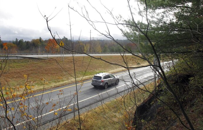 A car merges from an on ramp onto Interstate 91 on Monday Oct. 28, 2019, in Ascutney, Vt. The interstate runs on land that once belonged to Romaine Tenney's farm, that was seized in 1964 to make way for the interstate highway. Tenney burned his barn and his home, with him inside. (AP Photo/Wilson Ring)