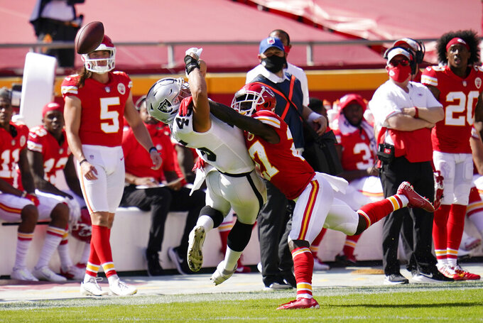 Kansas City Chiefs cornerback Rashad Fenton, right, breaks up a pass intended for Las Vegas Raiders fullback Alec Ingold, left, during the second half of an NFL football game, Sunday, Oct. 11, 2020, in Kansas City. (AP Photo/Jeff Roberson)