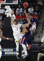 Maryland 's Anthony Cowan Jr. (1) fouls Belmont 's Kevin McClain who shoots during the second half of a first round men's college basketball game in the NCAA Tournament in Jacksonville, Fla., Thursday, March 21, 2019. (AP Photo/John Raoux)