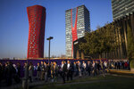 In this Feb. 25, 2019 photo, attendees walk to enter at the Mobile World Congress wireless show, in Barcelona, Spain. Organizers of the world's biggest mobile technology fair are pulling the plug over worries about the viral outbreak from China. The annual Mobile World Congress show will no longer be held as planned in Barcelona, Spain, on Feb. 24-27, 2020. (AP Photo/Emilio Morenatti)
