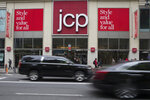 In this Wednesday, May 16, 2018, photo, traffic makes it's past the JC Penney logo hanging outside the Manhattan mall in New York. (AP Photo/Mary Altaffer)