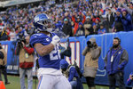 New York Giants running back Saquon Barkley (26) reacts after scoring touchdown against the Miami Dolphins during the third quarter of an NFL football game, Sunday, Dec. 15, 2019, in East Rutherford, N.J. (AP Photo/Seth Wenig)
