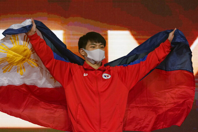 Carlos Edriel Yulo, of the Philippines, poses during the victory ceremony for the the vault final in the FIG Artistic Gymnastics World Championships in Kitakyushu, western Japan, Sunday, Oct. 24, 2021. (AP Photo/Hiro Komae)