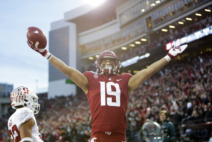 Washington State wide receiver Brandon Arconado (19) celebrates his touchdown during the second half of an NCAA college football game against Stanford in Pullman, Wash., Saturday, Nov. 16, 2019. Washington State won 49-22. (AP Photo/Young Kwak)