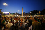 """People stage a protest against the COVID-19 vaccination pass in Rome, Wednesday, July 28, 2021. Italy's government approved a decree ordering the use of the so-called """"green"""" passes starting on Aug. 6. To be eligible for a pass, individuals must prove they have received at least one vaccine dose in the last nine months, recovered from COVID-19 in the last six months or tested negative in the previous 48 hours. (Cecilia Fabiano/LaPresse via AP)"""