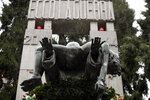 The bronze ossuary monument entitled 'Ecco La Guerra', (Here is War) dedicated to the 'Little Martyrs of Gorla', in memory of a World War II bombing raid on Oct. 20 1944 is pictured in Milan, Italy, Sunday, Oct. 20, 2019. Milan's mayor Giuseppe Sala, following a Mass Sunday for the 75th anniversary of the raid, asked U.S. authorities to apologize for a World War II bombing raid that killed 184 elementary school children. (AP Photo/Luca Bruno)