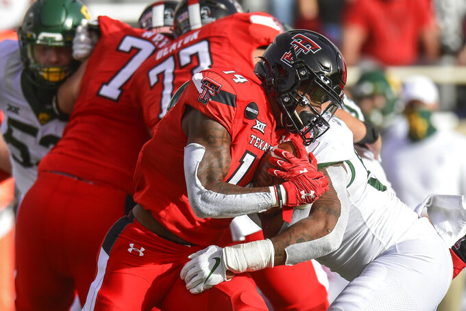 Texas Tech running back Xavier White (14) carries the ball against Baylor during the first half of an NCAA college football game in Lubbock, Texas, Saturday, Nov. 14, 2020. (AP Photo/Justin Rex)