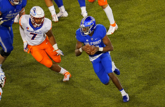Boise State linebacker Ezekiel Noa, left, pursues Air Force quarterback Warren Bryan during the second half of an NCAA college football game Saturday, Oct. 31, 2020, at Air Force Academy, Colo. (AP Photo/David Zalubowski)