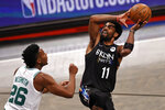 Brooklyn Nets guard Kyrie Irving, right, shoots over Boston Celtics forward Aaron Nesmith, left,  in the second half of Game 5 during an NBA basketball first-round playoff series, Tuesday, June 1, 2021, in New York. (AP Photo/Adam Hunger)
