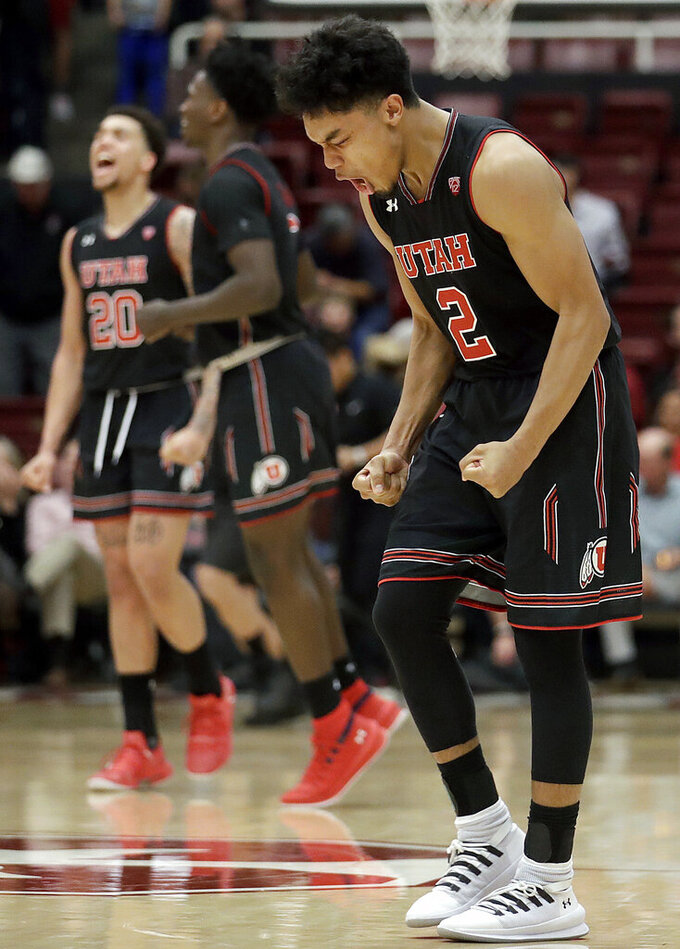 Utah guard Sedrick Barefield celebrates near teammates after Utah defeated Stanford in an NCAA college basketball game in Stanford, Calif., Thursday, Jan. 24, 2019. (AP Photo/Jeff Chiu)