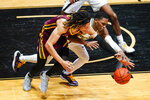 Minnesota forward Brandon Johnson, left, and Purdue guard Brandon Newman go for a loose ball during the first half of an NCAA college basketball game in West Lafayette, Ind., Saturday, Jan. 30, 2021. (AP Photo/Michael Conroy)