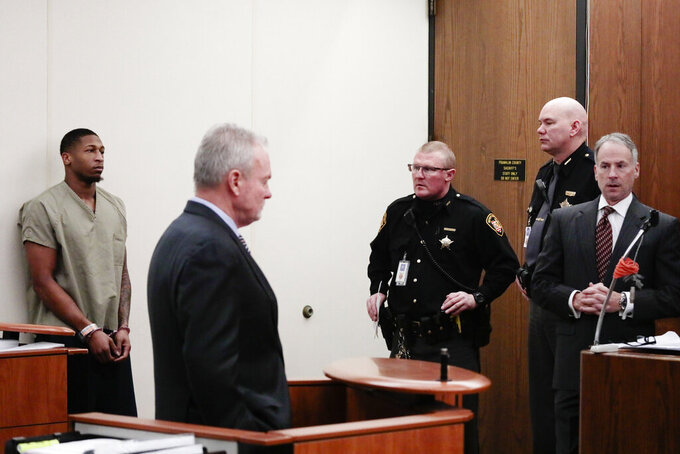 Former Ohio State Buckeyes football player Amir Riep, left, listens as his counsel, Karl Schneider, center, speaks during his arraignment on Thursday, Feb. 13, 2020, at the Franklin County Municipal Courthouse in Columbus, Ohio. Riep, who was dismissed from the team on Feb. 12, 2020 ,along with teammate and co-defendant Jahsen Wint, are charged with the rape and kidnapping of a 19-year-old woman on Feb. 4, 2020 at an apartment the two men share. (Joshua A. Bickel/The Columbus Dispatch via AP)