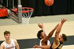 California guard Matt Bradley (20) shoots as Washington State center Dishon Jackson defends while forward Aljaz Kunc, left, watches during the first half of an NCAA college basketball game Thursday, Feb. 18, 2021, in Pullman, Wash. (AP Photo/Pete Caster)