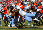 Virginia's tailback Jordan Ellis (1) is tackled by North Carolina's Mats PokelaHear (93) during the first half of an NCAA college football game Saturday, Oct. 27, 2018, in Charlottesville, Va. (Zack Wajsgras /The Daily Progress via AP)