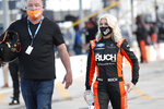 Driver Angela Ruch walks through the infield before a NASCAR Truck Series auto race at Charlotte Motor Speedway Tuesday, May 26, 2020 in Concord, N.C. (AP Photo/Gerry Broome)
