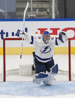 Tampa Bay Lightning goaltender Andrei Vasilevskiy celebrates the team's overtime win over the New York Islanders in Game 6 of the NHL hockey Eastern Conference final, Thursday, Sept. 17, 2020, in Edmonton, Alberta. (Jason Franson/The Canadian Press via AP)