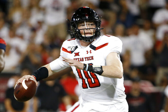 FILE - In this Sept. 14, 2019, file photo, Texas Tech quarterback Alan Bowman looks to pass the ball against Arizona during the second half of an NCAA college football game in Tucson, Ariz. Max Duggan and Bowman have come back throwing strong again in the Big 12 after both experienced different health issues. Bowman twice dealt with a partially collapsed lung that year, and then broke his collarbone in the third game last season. (AP Photo/Ralph Freso, File)