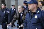 Harvey Weinstein leaves a Manhattan courthouse following jury selection for his trial on rape and sexual assault charges, Friday, Jan. 17, 2020, in New York. (AP Photo/Seth Wenig)