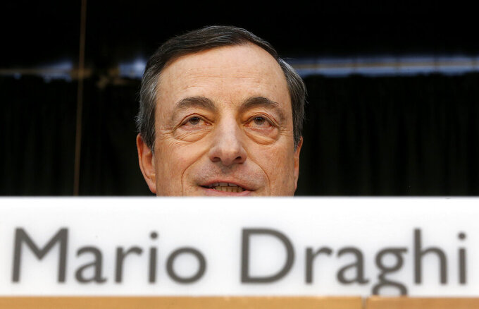 """FILE - In this Thursday, June 5, 2014 file photo, the President of the European Central Bank Mario Draghi speaks during a news conference in Frankfurt, Germany. Italy's weary president on Wednesday, Feb. 3, 2021 tapped """"Super Mario,"""" arguably the world's most famous Italian, to resolve a festering political crisis that threatens the ability of the eurozone's third-largest economy to manage the coronavirus pandemic and recover from the worst recession since World War II. (AP Photo/Michael Probst, File)"""