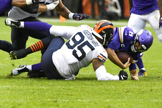 Minnesota Vikings quarterback Kirk Cousins (8) is sacked by Chicago Bears defensive end Roy Robertson-Harris (95) during the second half of an NFL football game Sunday, Sept. 29, 2019, in Chicago. (AP Photo/Matt Marton)