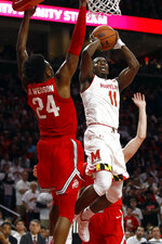 Maryland guard Darryl Morsell, right, shoots over Ohio State forward Andre Wesson in the second half of an NCAA college basketball game, Saturday, Feb. 23, 2019, in College Park, Md. Maryland won 72-62. (AP Photo/Patrick Semansky)