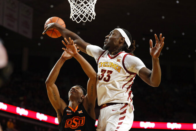 Iowa State forward Solomon Young (33) blocks a shot by Oklahoma State guard Avery Anderson III during the second half of an NCAA college basketball game, Tuesday, Jan. 21, 2020, in Ames, Iowa. Iowa State won 89-82. (AP Photo/Charlie Neibergall)