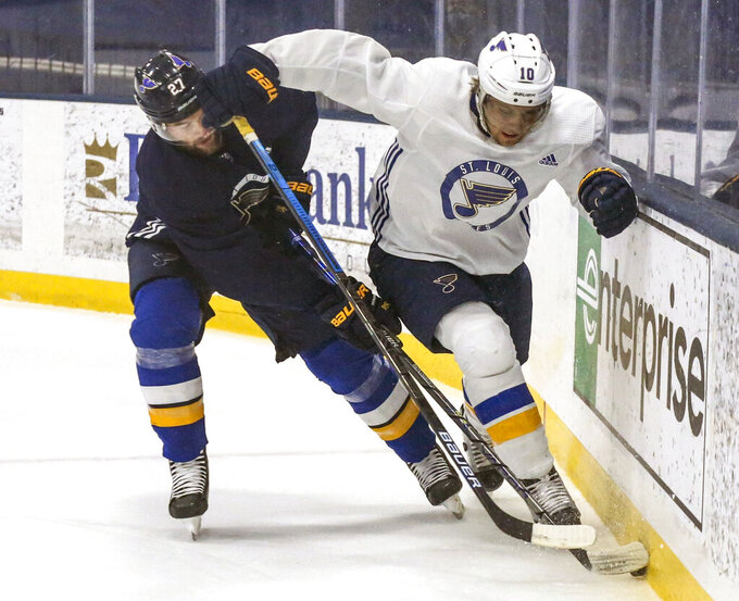 St. Louis Blues defenseman Alex Pietrangelo (27) and center Brayden Schenn (10) battle for the puck during the first period of an intraquad NHL hockey scrimmage at the Centene Community Ice Center in Maryland Heights, Mo., Saturday, July. 18, 2020. (Colter Peterson/St. Louis Post-Dispatch via AP)