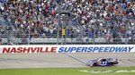 FILE -- In this April 3, 2010, file photo, Kevin Harvick takes the checkered flag at the finish line to win the NASCAR Nationwide Series Nashville 300 auto race at Nashville Superspeedway in Gladeville, Tenn. NASCAR is set to return to the track in 2021. Nashville Superspeedway will hold a Cup race for the first time next season.  It ends NASCAR's decade-long drought at the track. (AP Photo/Mark Humphrey, File)