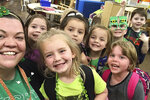 In this March 12, 2020 photo,Tabatha Rosproy, 2020 National Teacher of the Year, is shown with her pre-school students in Winfield, Kansas. The pre-school is housed at Cumbernauld Village, a retirement community and nursing home, and provides daily interaction between students and residents, who serve as