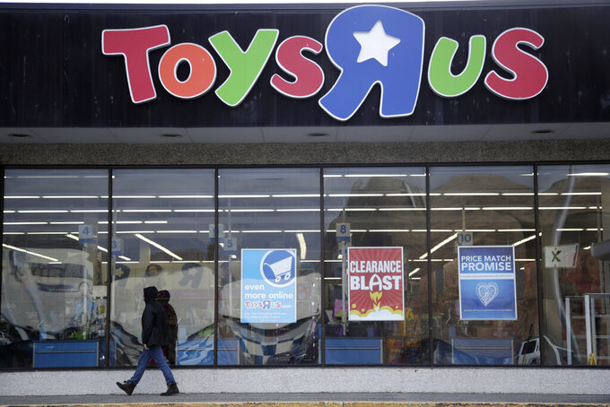 FILE - In this Jan. 24, 2018, file photo, a person walks near the entrance to a Toys R Us store, in Wayne, N.J. WHP Global, a New York-based brand management firm that already owns Anne Klein and Joseph Abboud, is taking a controlling stake in the parent company of the Toys R Us and Babies R Us brands. The deal, announced Monday, March 15, 2021, comes nearly two months after the closure of the only two Toys R Us stores that were part of a small U.S. comeback attempt by the iconic toy chain.  (AP Photo/Julio Cortez, File)