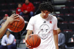 Wearing a T-shirt in tribute to former Los Angeles Lakers star Kobe Bryant, Rutgers guard Geo Baker handles the ball while warming up for the team's NCAA college basketball game against Purdue, Tuesday, Jan. 28, 2020, in Piscataway, N.J. Bryant and his daughter Gianna, 13, died along with seven others in a helicopter crash Sunday while traveling to his daughter's basketball practice in California. (AP Photo/Kathy Willens)