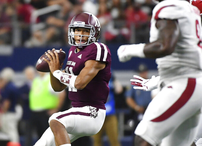 Texas A&M quarterback Kellen Mond (11) looks to pass against Arkansas during the first quarter of an NCAA college football game Saturday, Sept. 29, 2018, in Arlington, Texas. (AP Photo/Jeffrey McWhorter)