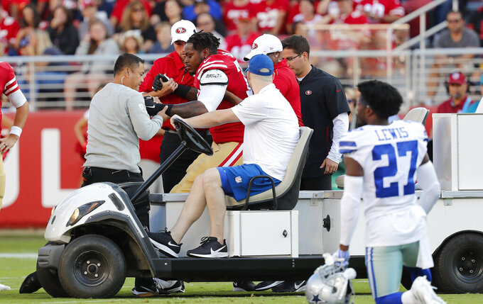 San Francisco 49ers offensive tackle Shon Coleman, center left, is helped onto a cart during the first half of the team's NFL preseason football game against the Dallas Cowboys in Santa Clara, Calif., Saturday, Aug. 10, 2019. (AP Photo/Josie Lepe)