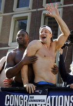 New England Patriots tight ends Dwayne Allen, left, and Rob Gronkowski react to fans during their victory parade through downtown Boston, Tuesday, Feb. 5, 2019, to celebrate their win over the Los Angeles Rams in Sunday's NFL Super Bowl 53 football game in Atlanta. The Patriots have won six Super Bowl championships. (AP Photo/Elise Amendola)